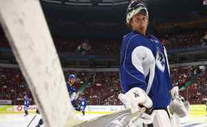 Vancouver Canucks goaltender Roberto Luongo has some fun with his weapon of choice during a practice at Rogers Arena October 3, 2010 in Vancouver. Jeff Vinnick-The Globe and Mail