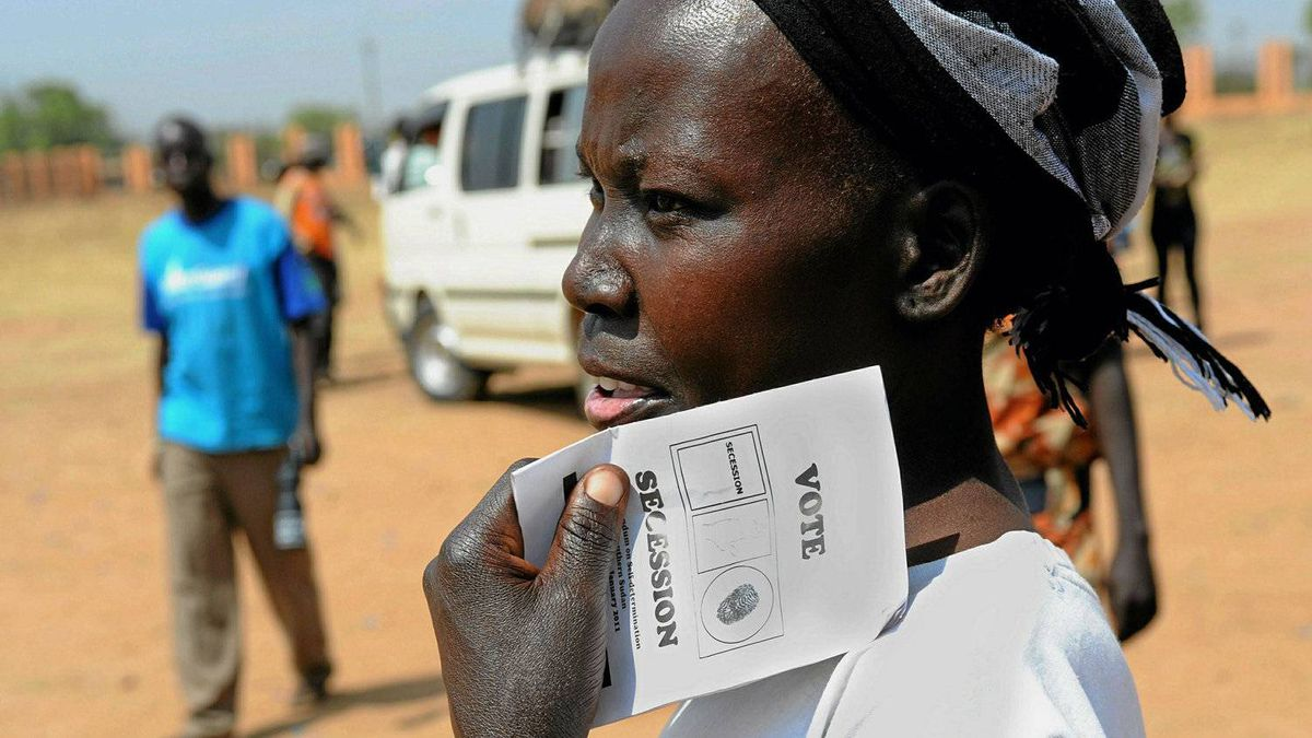 A handout picture from the United Nations Mission in Sudan (UNMIS) shows a southern Sudanese woman holding a ballot paper ahead of the upcoming Southern Sudan independence referendum during a rally in Juba on January 7, 2011.