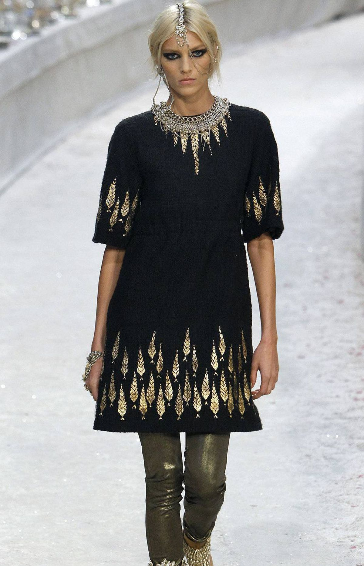 This is the difference between costume and fashion. Lagerfeld streamlines a traditional tunic while adding a French touch of je ne sais quoi.