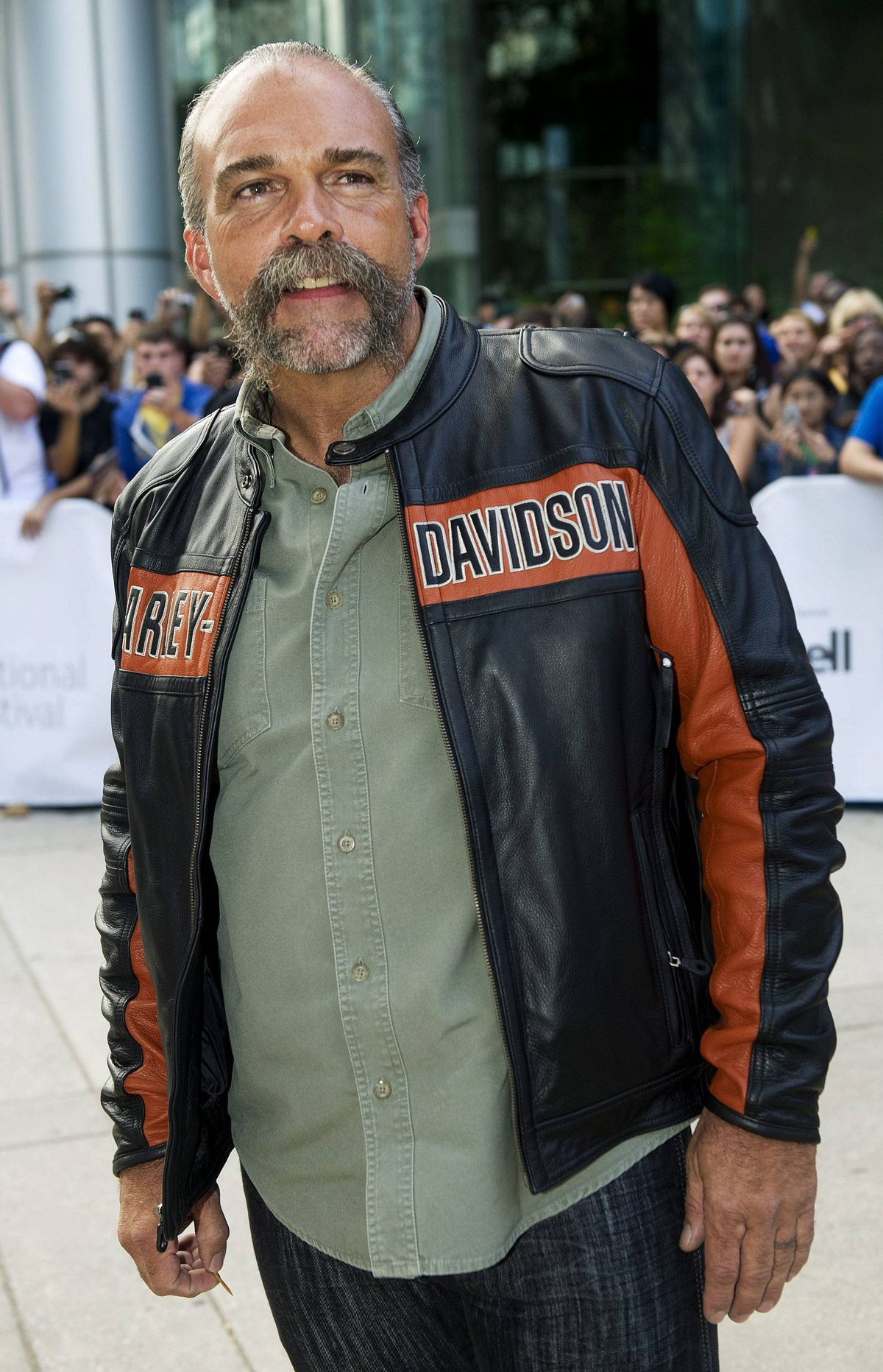 "Sam Childers poses for photographs on the red carpet as he arrives for the new movie ""Machine Gun Preacher"" at the Toronto International Film Festival in Toronto on Sunday, Sept., 11, 2011."