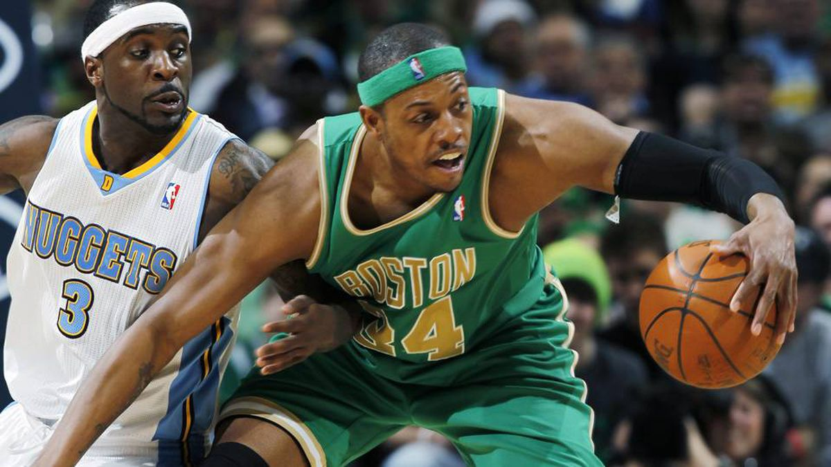 Boston Celtics forward Paul Pierce, right, reaches out to pull in a loose ball as Denver Nuggets guard Ty Lawson defends in the third quarter of the Nuggets' 98-91 victory in an NBA basketball game in Denver on Saturday.