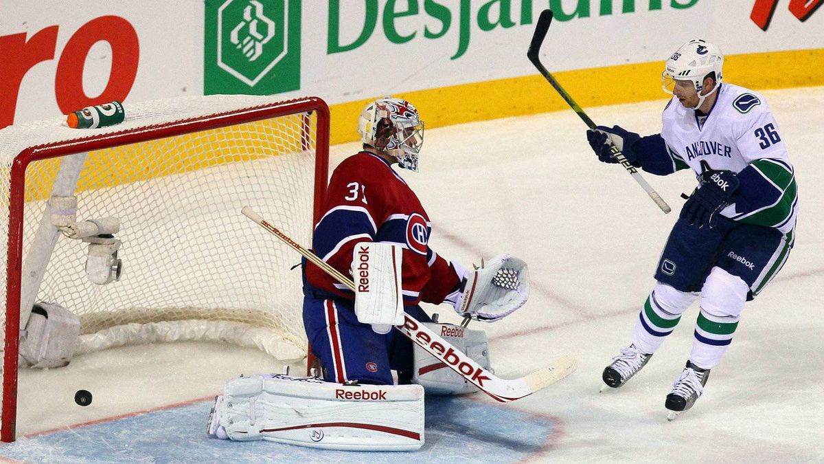 Vancouver Canucks left wing Mason Raymond (not pictured) scores a goal against Montreal Canadiens goalie Carey Price (31) as right wing Jannik Hansen (36) looks on during the second period at the Bell Center in Montreal, Quebec, Canada.