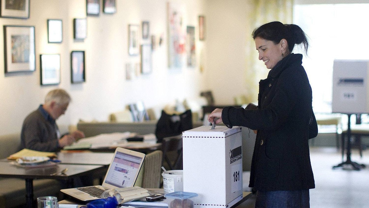 A woman casts her vote for the federal election in a polling station on Toronto's Ward Island on Monday May 2, 2011.