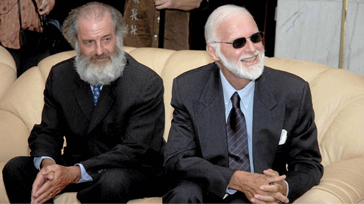 Canadians Louis Guay, left, and Robert Fowler are shown here after thy were released by al-Qaeda-linked captors in 2009. Records show that Libya had a hand in securing their release.