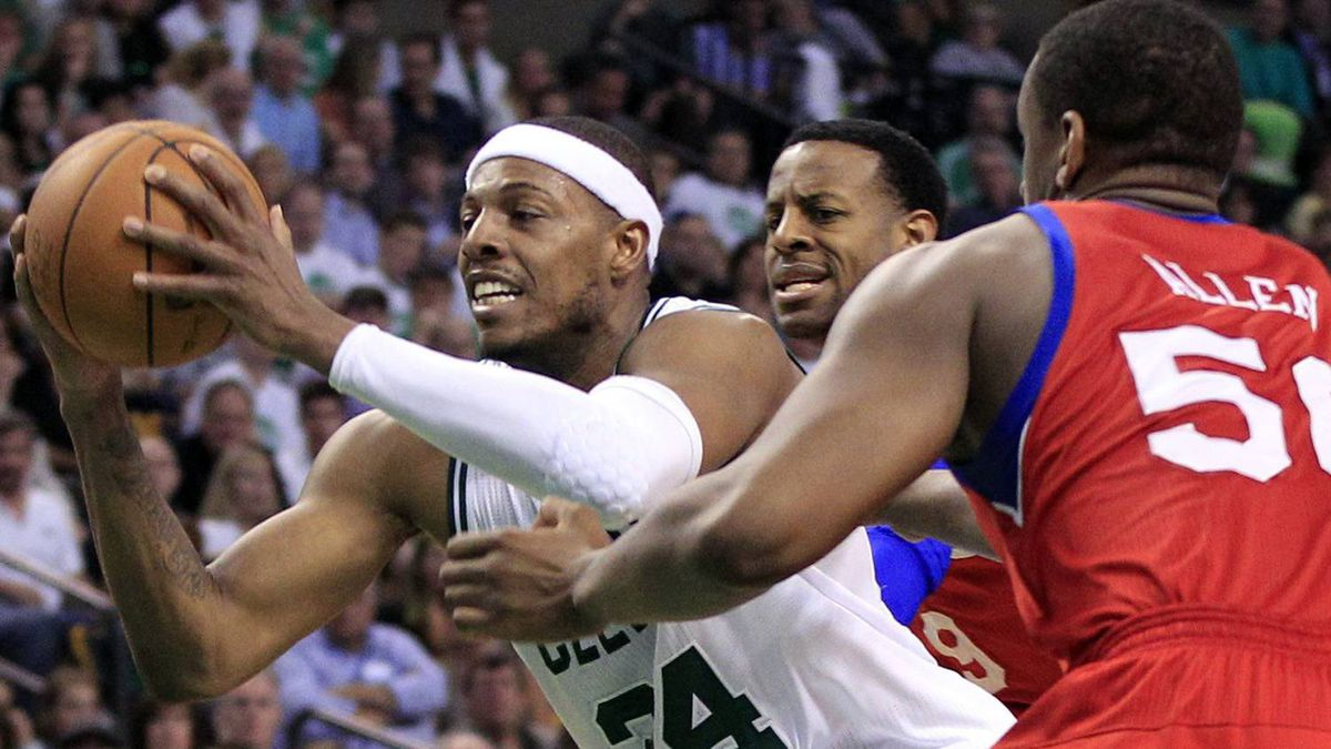 Boston Celtics forward Paul Pierce (34) drives through the defense of Philadelphia 76ers forwards Lavoy Allen (50) and forward Andre Iguodala during the second quarter. (AP Photo/Elise Amendola)