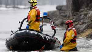A rescue team searches a river close to a wooded area in Laval, Que., near Montreal, Monday, April 4, 2011, where three-year-old autistic boy Adam Benhamma went missing on March 3.