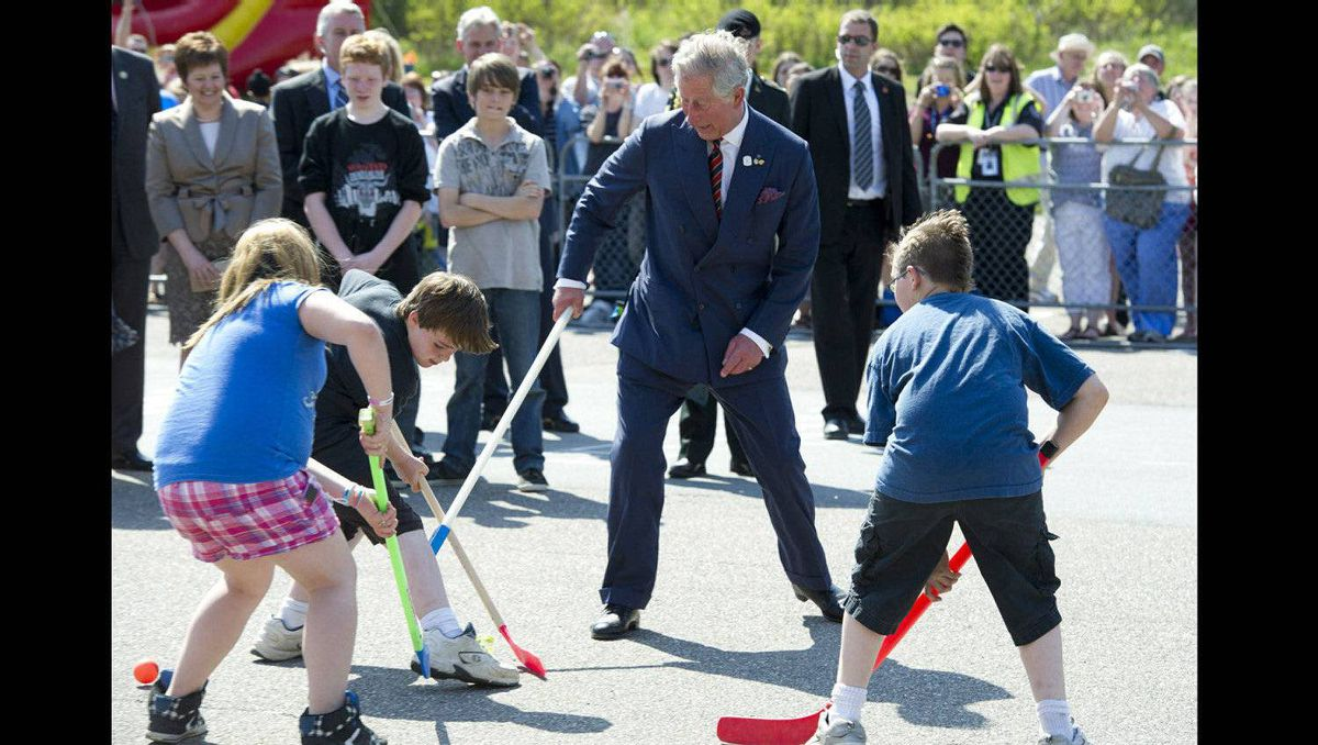 Prince Charles plays road hockey while touring the Hazen White-St Francis School in Saint John, N.B., on Monday, May 21, 2012. The royal couple are on a three-day visit to Canada to mark the Queen's Diamond Jubilee.