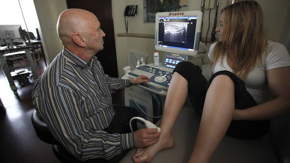 Rheumatologist Abraham Chaiton uses ultrasound to diagnose and monitor rheumatoid arthritis patients like Nicole Pittman, 21, at his medical practice on March 15, 2012 in Toronto.