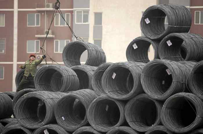 Coils of steel wire at a steel wholesale market in Beijing: Rio Tinto warned Tuesday that growth in China's steel output is slowing.