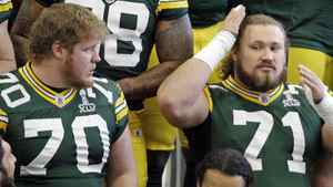 Members of the Green Bay Packers prepare for their team photo on Feb. 4, 2011, in Dallas, whre they will face the Pittsburgh Steelers in the NFL football Super Bowl.