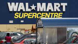 Customers head in and out of a Walmart Supercentre location in Scarborough, Ontario