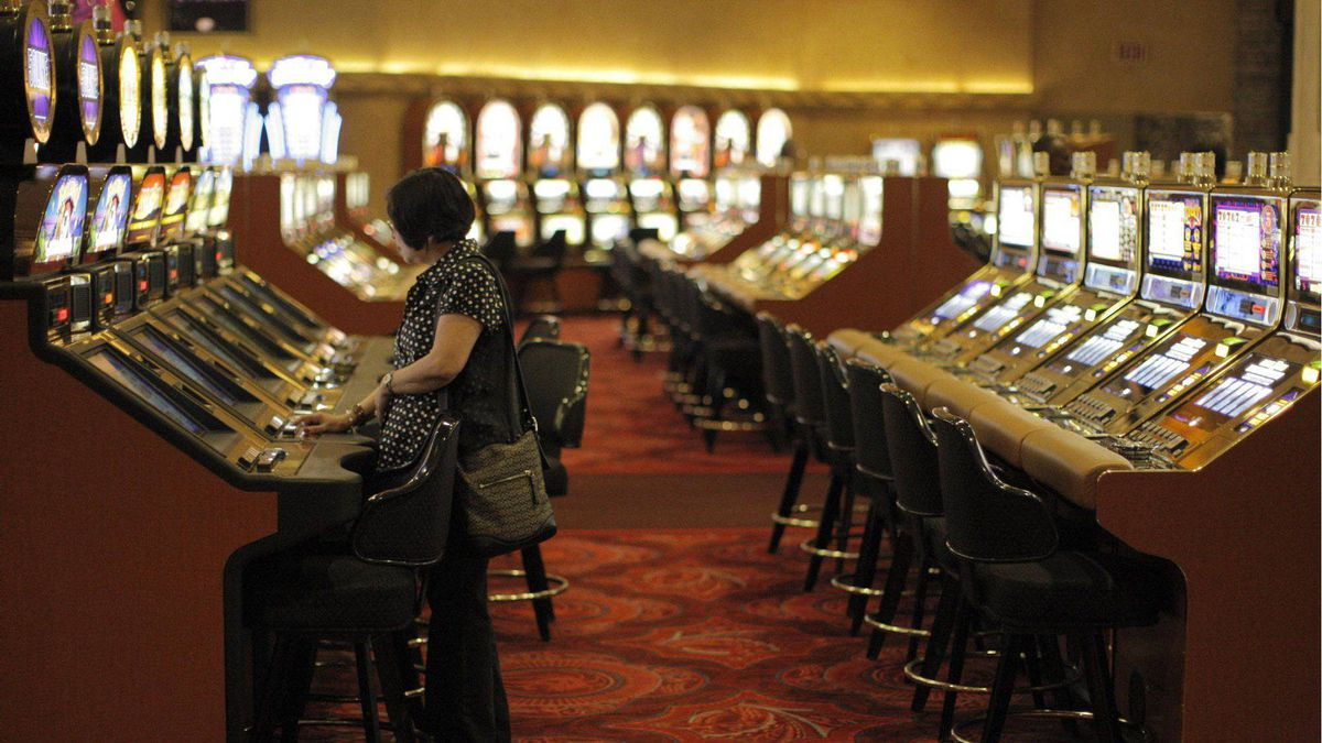 A tourist plays a slot machine at the MGM Grand in Las Vegas, Nov. 18, 2008.