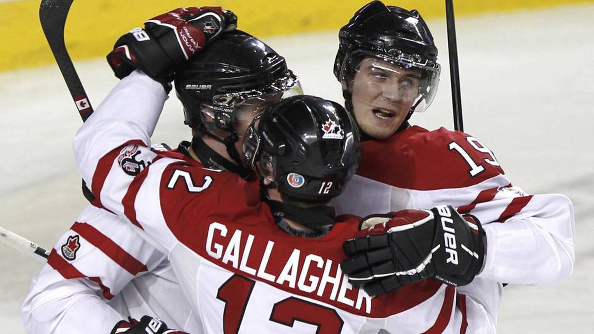 Canada's Tanner Pearson (obscured) celebrates his goal with teammates Brendan Gallagher and Mark Scheifele.