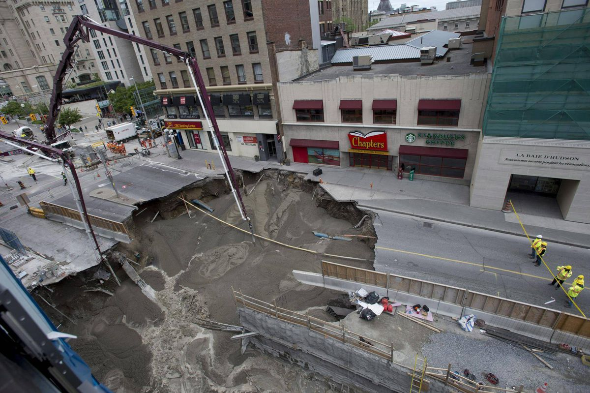 Concrete poured into Ottawa sinkhole, but street could be closed for ...