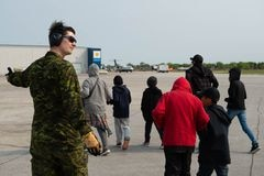 Residents wait to leave Pikangikum First Nation, a week