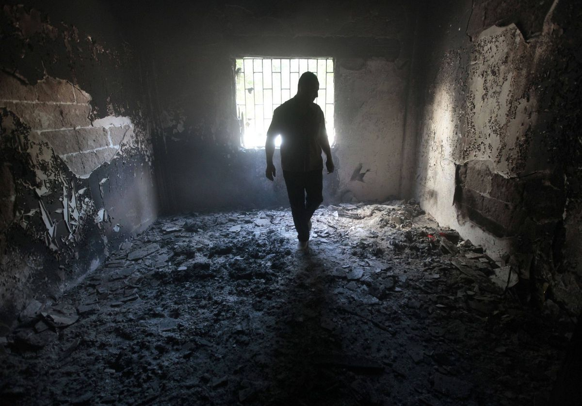 An Alawite man checks his burned house, after the Lebanese army deployed at the Alawite majority area of Jabal Mohsen, in the northern port city of Tripoli, Lebanon, Tuesday May 15, 2012.