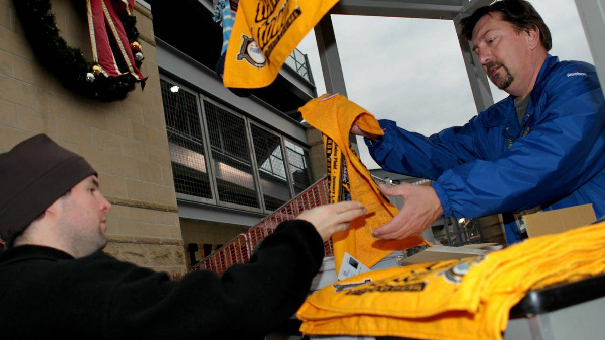 """Terrible Towels"" are sold prior to the start of the 2011 NHL Bridgestone Winter Classic between the Washington Capitals and the Pittsburgh Penguins at Heinz Field on January 1, 2011 in Pittsburgh, Pennsylvania. (Photo by Jamie Squire/Getty Images)"