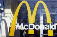 McDonald's logo is seen on the window of one of its restaurants in New York.