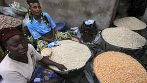 Women selling grains wait for customers at the Bodija market in Ibadan, southwest Nigeria
