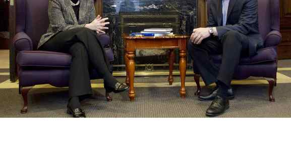 Ontario Premier Dalton McGuinty chats with Alberta Premier Alison Redford in his office at the Ontario Legislature in Toronto on Nov. 16, 2011.