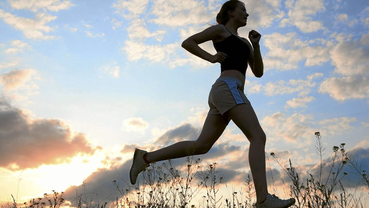 File #: 10060150 Silhouette woman run under blue sky with clouds and sun Credit: iStockphoto (Royalty-Free) Keywords: Running, Jogging, Women, Exercising, Sport, Silhouette, Female, Outdoors, Marathon, Leg, Athlete, Sun