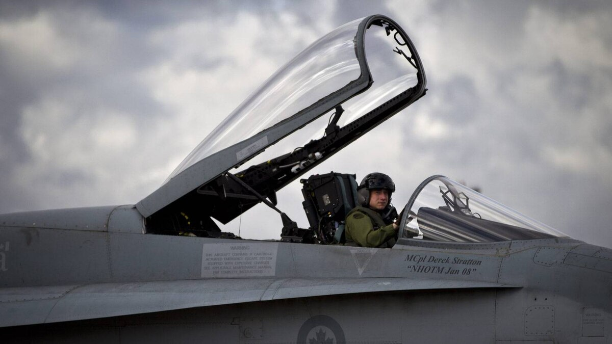 Pilot and Captain Mark Remington climbs out of his CF-18 in CFB Cold Lake.