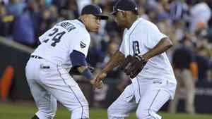 Detroit Tigers first baseman Miguel Cabrera (L) and pitcher Jose Valverde celebrate after the Tigers defeated the Texas Rangers in Game 3 of the MLB American League Championship Series baseball playoffs in Detroit, October 11, 2011.