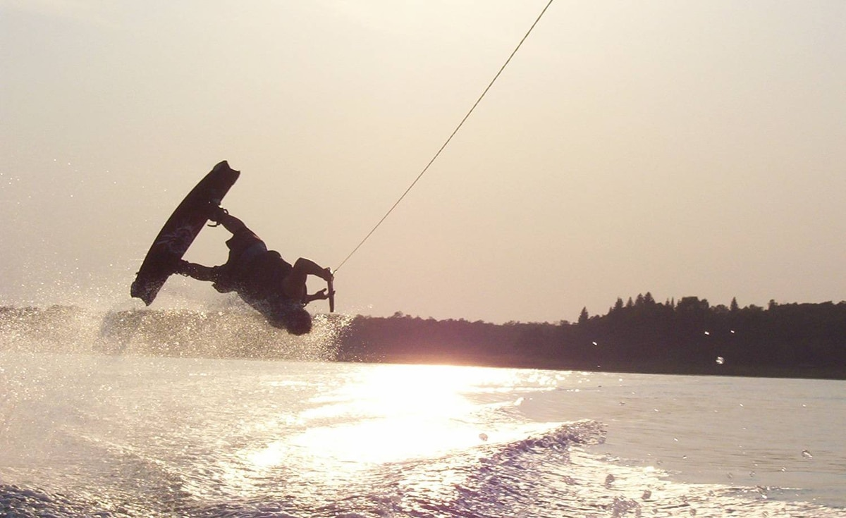 "Jen Balfour sent us this photo of ""Chippy's back-flip over Kenosee Lake waters, Saskatchewan"""