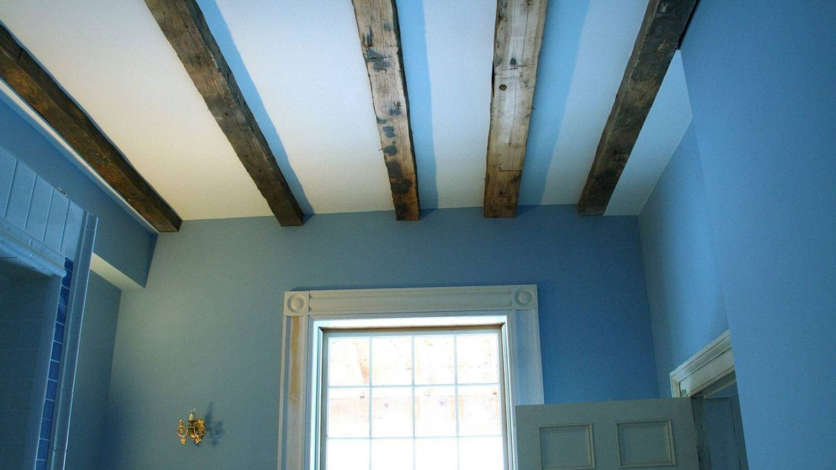 Exposed beams in the master bedroom.