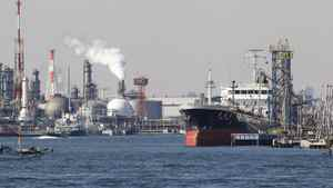 An oil tanker is moored at an oil loading platform adjacent to an oil refinery in Kawasaki, west of Tokyo, Monday, Feb. 20, 2012. Japan posted a record high trade deficit in January after its nuclear crisis shut down nearly all the nation's reactors for tougher checks, sending fuel imports surging. Exports were hurt by a strong yen and weak demand.