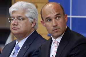 Research In Motion co-CEO Jim Balsillie, right, and president and co-CEO Mike Lazaridis listen during the annual general meeting of shareholders in Waterloo, Ont., on July 14, 2009.