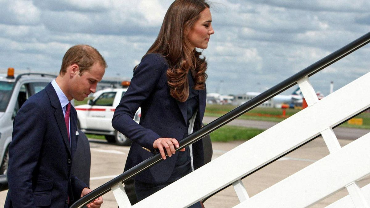 Prince William and Catherine, Duchess of Cambridge, board a plane bound for Canada at London's Heathrow Airport on June 30, 2011.