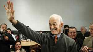 NDP Leader Jack Layton waves to the crowd as he leaves a Quebec City restaurant during a campaign stop on April 18, 2011.