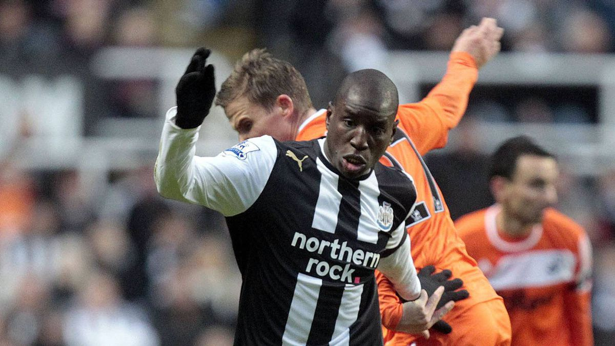 Newcastle United's Senegalese striker Demba Ba (front) vies with Swansea City's Mark Gower during their English FA Premier League football match at St James' Park, in Newcastle upon Tyne on December 17, 2011.