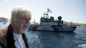 President of the Sea Shepherd Conservation Society, Paul Watson, answers questions while sailing aboard a trimaran off the harbor of La Ciotat, southern France, May 25, 2011. On background is the Sea Shepherd vessel : Steve Irwin.