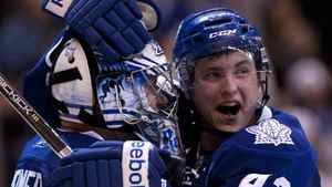 Toronto Maple Leafs' Tyler Bozak (right) embraces goaltender James Reimer after the Maple Leafs defeated the Buffalo Sabres 4-3 in NHL hockey action in Toronto on Saturday March 12, 2011.THE CANADIAN PRESS/Chris Young