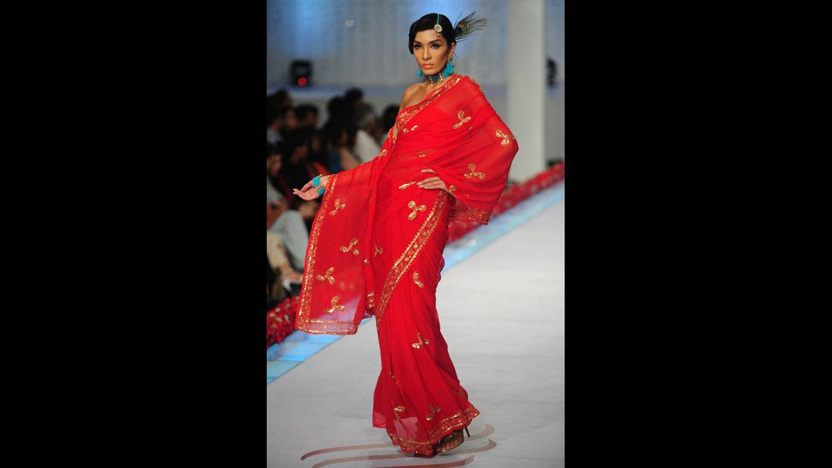 A model presents a creation by Pakistani designer Reem Abbasi on the last day of Bridal Couture Week, in Karachi, on April 24, 2011.