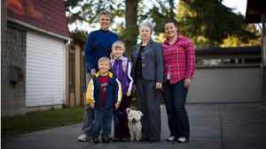 The Graham-Radford family poses for a portrait outside their daughter's home in Burnaby, British Columbia, Thursday, September 29, 2011. From left to right Lindsey Graham, Jan Radford, Mikaela Graham-Radford, 21, Hunter Graham-Radford, 5, Heather Graham-Radford, 8, and their dog Katie.