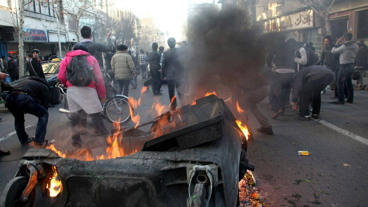 A garbage container is set on fire as Iranian protesters stage an anti-government demonstration, under the pretext of rallies supporting Arab uprisings, in Tehran on February 14, 2011.