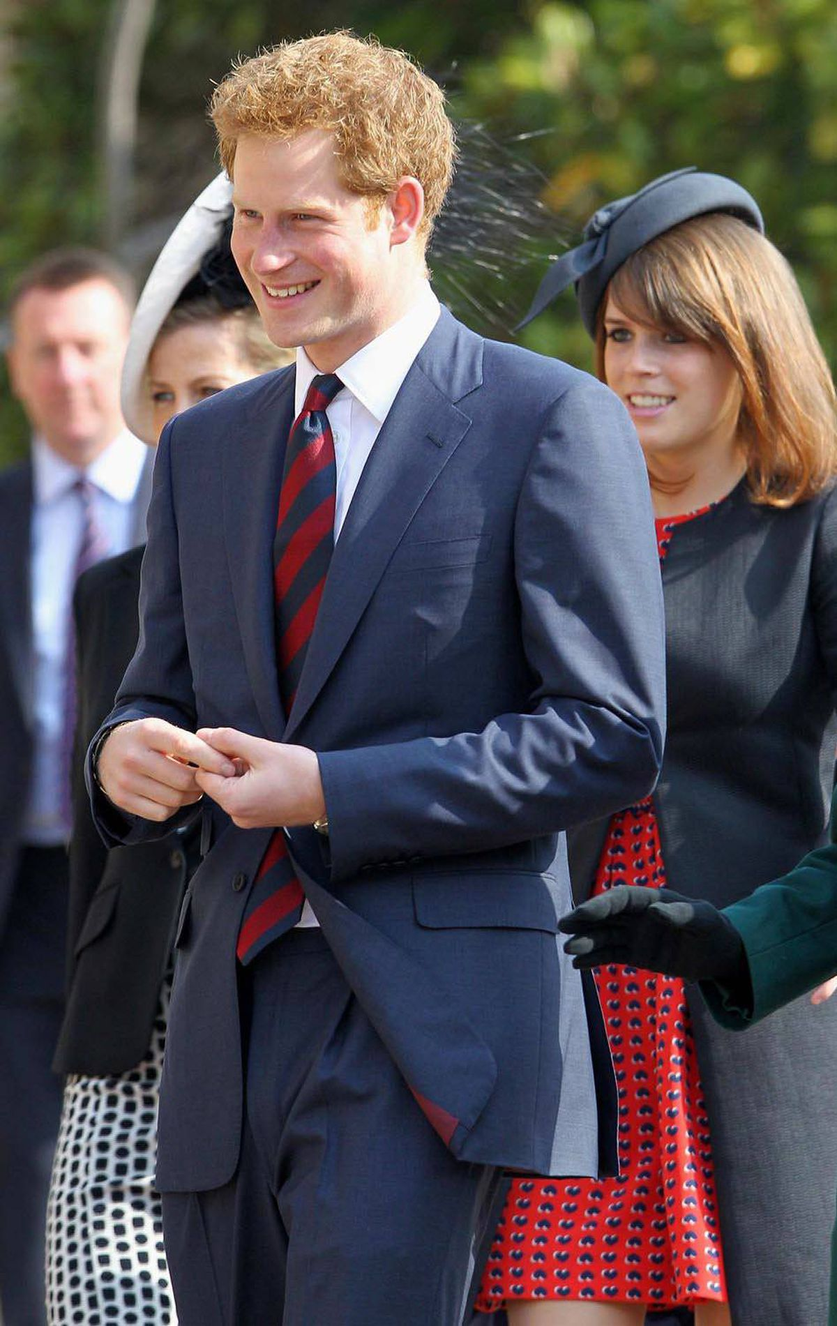 DAPPER Britain's Prince Harry arrives with Princess Eugenie for a thanksgiving service for the Queen Mother and Princess Margaret at St George's Chapel in Windsor, England March 30, 2012.