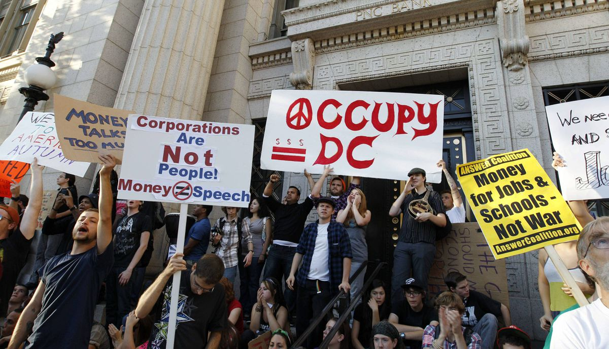 Demonstrators protest outside of the PNC Bank building in Washington on Saturday, Oct. 8, 2011, as part of Occupy DC activities in Washington.