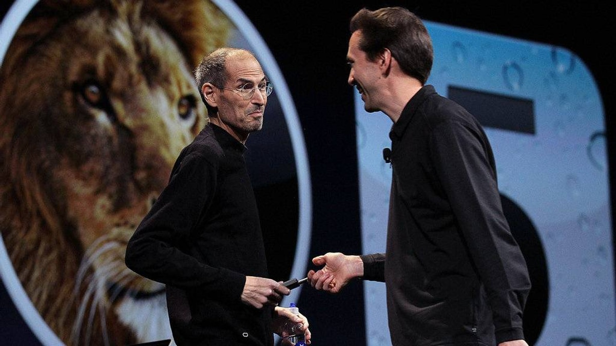 Apple CEO Steve Jobs jokes with Scott Forstall, Senior VP of iPhone Software as he delivers the keynote address at the 2011 Apple World Wide Developers Conference at the Moscone Center on June 6, 2011 in San Francisco, California.