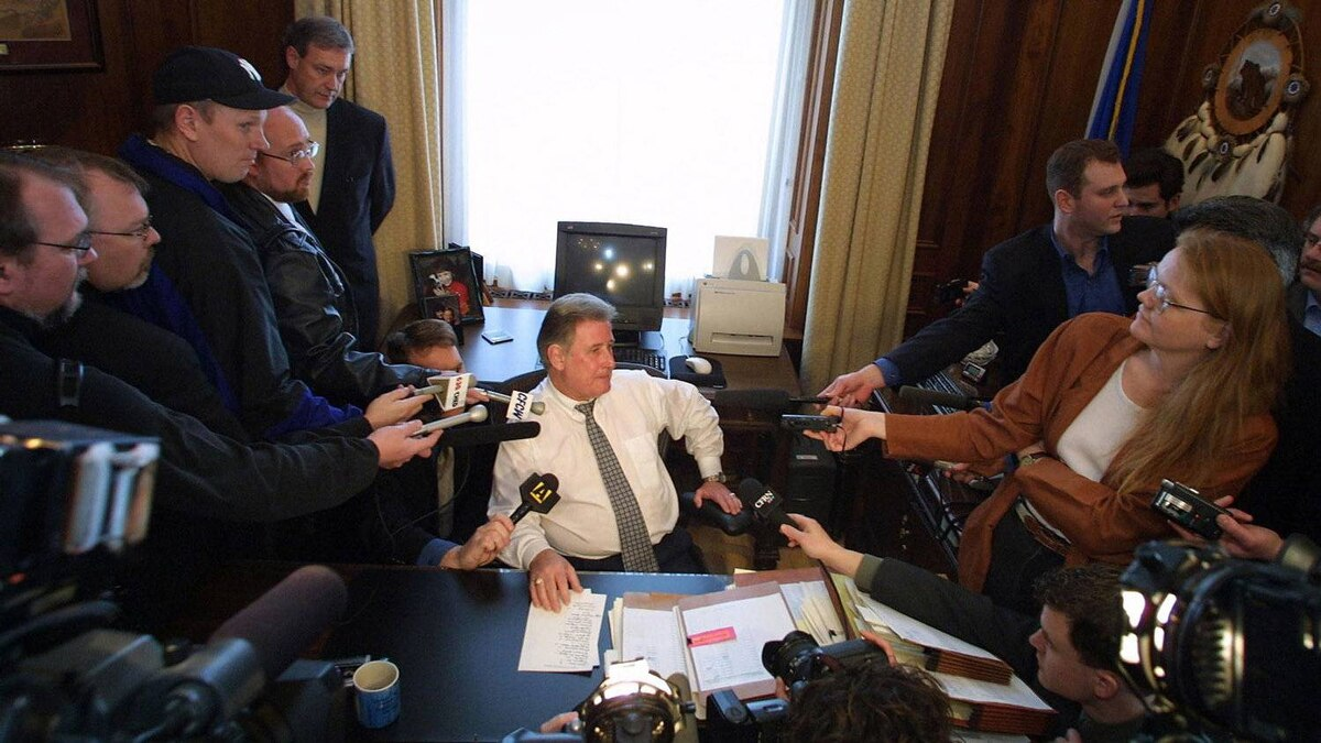 Mr. Klein talks to members of the media at his office in Edmonton, on March 12, 2001, prior to returning to Calgary to await the outcome of the 2011 provincial election.