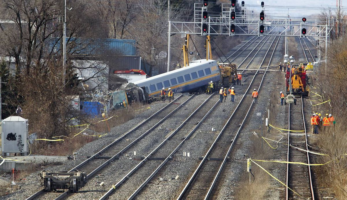 BURLINGTON, ONT. - Feb. 27, 2012 - The scene on Monday as crews investigate and prepare to remove the wreckage after Sunday's VIA train derailment. The Via passenger train, enroute from Niagara Falls to Toronto, derailed on Sunday at approximately 3:30pm. Three VIA employees in the engine died as a result if the crash, and many passengers were taken to local hospitals; three with serious injuries. (Photo by Peter Power/The Globe and Mail)pmp