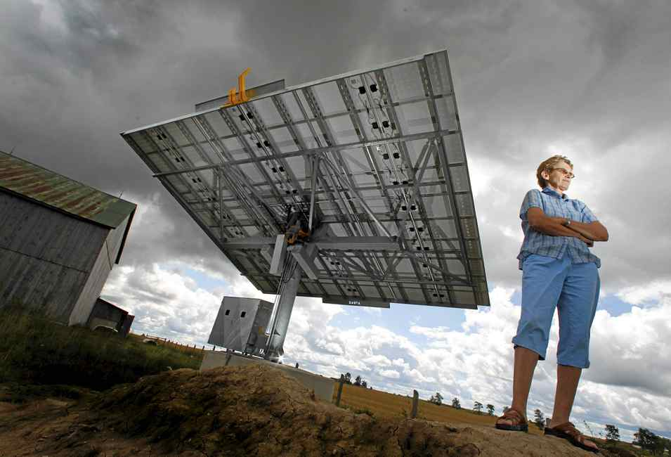 Rita Van Geffen, who believes in solar power, invested $105,000 into a small solar project. The large panel, erected on one of her family's farms, has been ready to go since September of last year, but has not yet been connected to the grid.