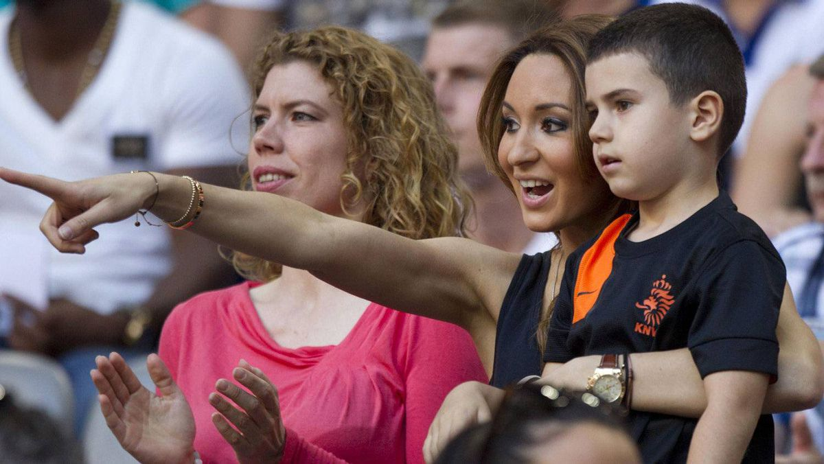 Bouchra van Persie (C) and her son Shaqueel look at players of the Netherlands prior to their friendly soccer match against Bulgaria in Amsterdam May 26, 2012. Bulgaria won 2-1. REUTERS/Michael Kooren