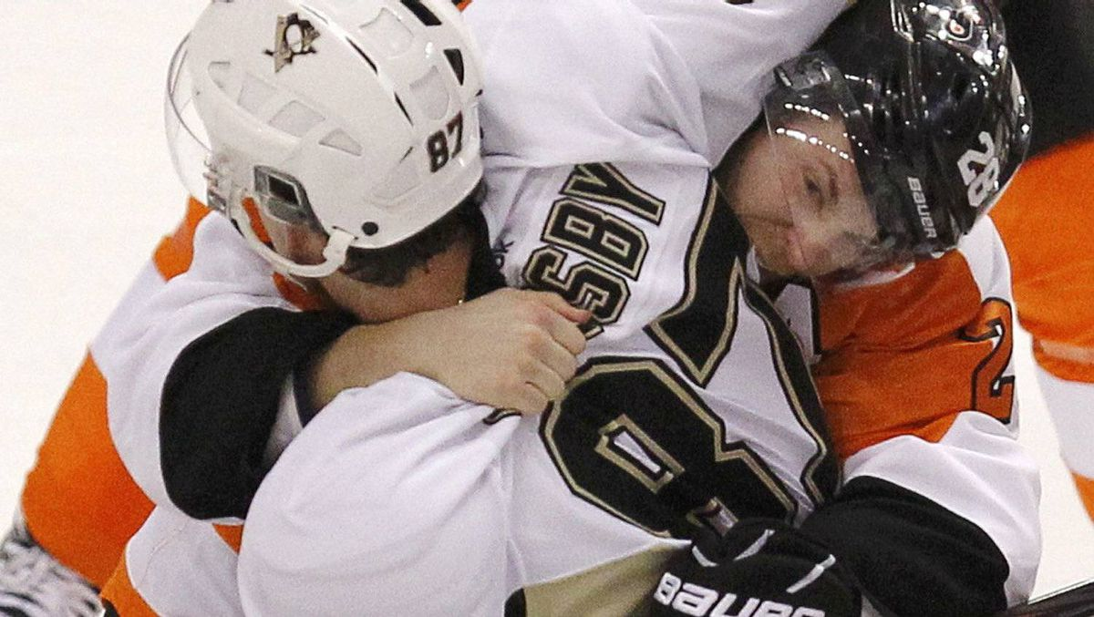 Pittsburgh Penguins' Sidney Crosby (L) fights with Philadelphia Flyers' Claude Giroux (R) during the first period in Game 3 of their NHL Eastern Conference quarterfinal playoff hockey series in Philadelphia, April 15, 2012. REUTERS/Tim Shaffer