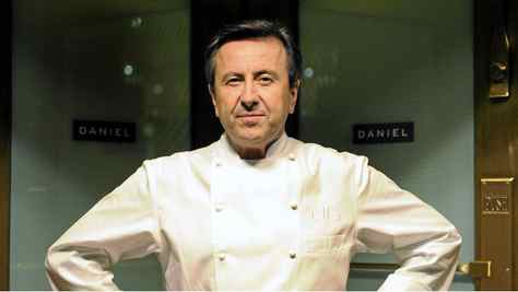 French chef Daniel Boulud poses at the entrance of his flagship restaurant a§aaa¨Daniela§aa¬ù in New York, October 27, 2009.