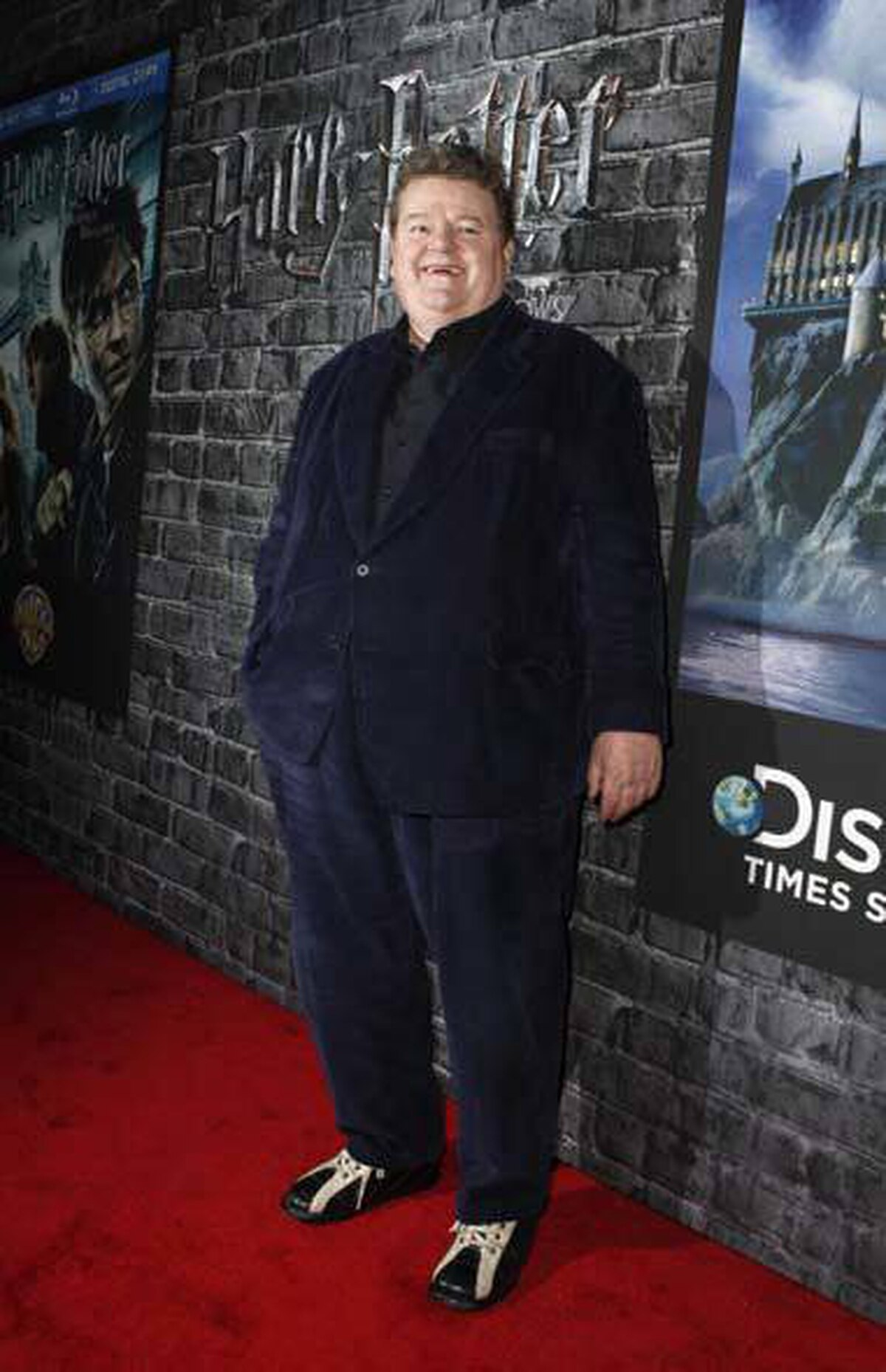 """Cast member Robbie Coltrane arrives at the launch of the """"Harry Potter and the Deathly Hallows - Part 1"""" movie in DVD and digital formats in New York on Monday."""