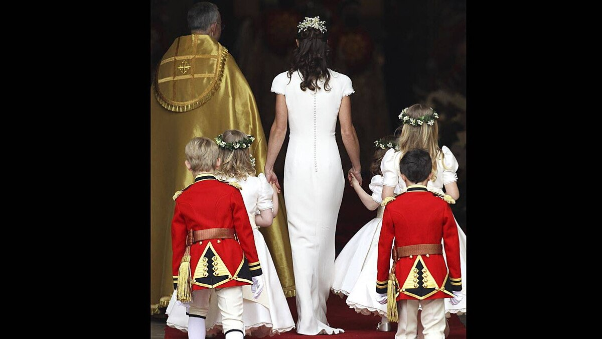 Maid of Honour Pippa Middleton with pageboys and bridemaids arrive to attend the Royal Wedding of Prince William to Catherine Middleton at Westminster Abbey on April 29, 2011 in London, England.